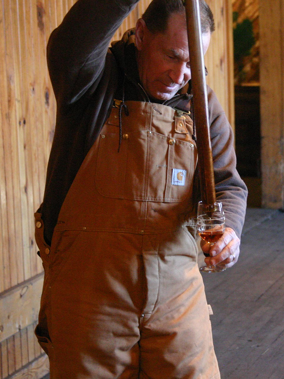 Pulling Bourbon from Barrel with Whiskey Thief